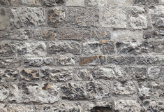Old grungy gray brick wall, closeup texture Royalty Free Stock Photography