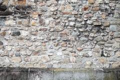 Old grungy gray stone wall, close-up texture Royalty Free Stock Photo