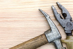 Old grungy hammer and pliers as instruments for house renovation Stock Image