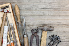 Old grungy hand tools including clamps, hammer and other instrum Royalty Free Stock Photos