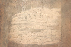 Old grungy painted wall background weathered frame painted orange with a grain texture Royalty Free Stock Images