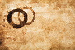 Old grungy paper with coffee stains Stock Images