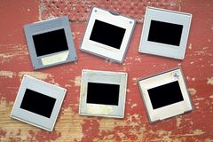 Old grungy photographic slides, free space for pics. Analog photography concept royalty free stock photography