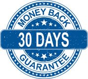 Blue money back 30 days guarantee rubber stamp internet sign on. Old grungy rubber stamp on white background Royalty Free Stock Photography
