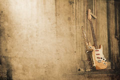 Old grungy sax with electric guitar. In retro look Royalty Free Stock Images