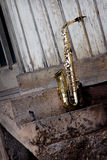 Old grungy saxophone. With old retro background Stock Images