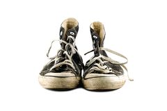 Old grungy sneakers isolated  on white background Royalty Free Stock Image