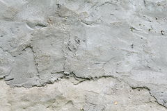 Old grungy texture, grey concrete wall. The texture of the concrete wall, wattle and daub plaster gray royalty free stock photo