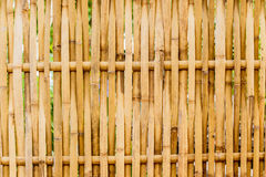 Old grungy thai handcraft of bamboo weave pattern fence. Royalty Free Stock Photos