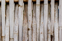 Old grungy thai handcraft of bamboo weave pattern fence. Royalty Free Stock Image