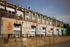 Old grungy warehouse on a pier Stock Image