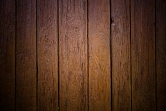 Old grungy and weathered brown wood surface wall plank texture background marked by damages outdoors. And vignetting with dark corners with retro vintage look stock photography