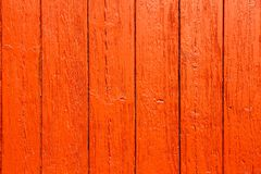 Old grungy and weathered red orange painted wooden wall plank simple texture background.  stock photography
