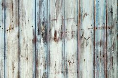 Old grungy and weathered white grey and blue painted wooden wall plank texture background weathered by long exposure. To the elements outdoors and with paint Stock Photography