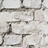 Old grungy white brick wall fragment Royalty Free Stock Photo