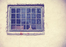 Old grungy window on an old dirty wall. Stock Photos