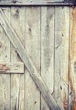 Old grungy wooden barn door. Stock Image