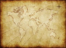 Old grungy world map on paper. An old world map drawn onto parchment paper stock illustration