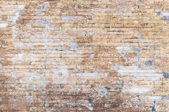 Old grungy yellow brick wall background texture Stock Images