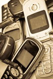 Old GSM phone. Old simple GSM mobile phone.Old style picture,sepia toned Stock Photos