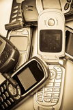 Old GSM phone. Old simple GSM mobile phone.Old style picture,sepia toned and vignetting applied Stock Photography