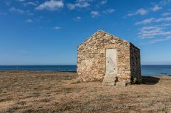Old guardhouse in the dunes stock photography