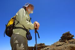 Old guide in mountains Stock Photography