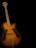Old guitar 2. Old guitar on black background Stock Image