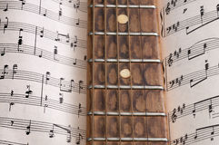Old guitar and notes. Old guitar and musical notes Stock Images