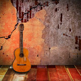 Old guitar with vintage room Royalty Free Stock Photos