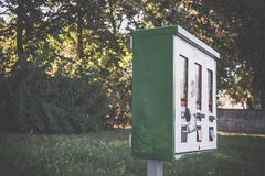 Old gumball machine. Old green gumball machine in nature royalty free stock image