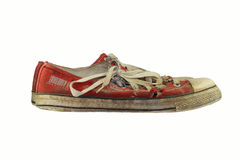 Old gumshoes. With a white background Royalty Free Stock Photos