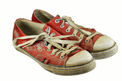 Old gumshoes. With a white background Stock Photography