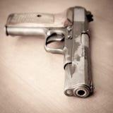 Old gun. On a table Royalty Free Stock Photos