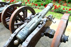 Old gun in the garden Stock Photo