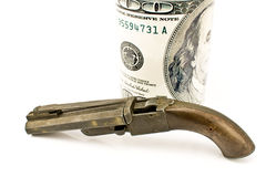 Old gun with hundred dollar bill Royalty Free Stock Image