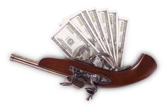 Old gun and hundred dollar bills Royalty Free Stock Photos