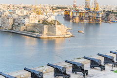Old gun in La Valletta and Fort St Angelo of La Vittoriosa in Ma. The old gun in La Valletta and Fort St. Angelo of La Vittoriosa in Malta Stock Image