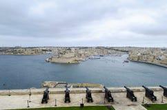 The old gun in La Valletta. And Fort St. Angelo of La Vittoriosa in Malta Stock Photo