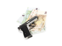 Old gun and money Stock Images