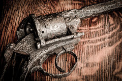 Old gun on wooden table Stock Images