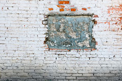 Old gungy wall with immured (bricked-up) window Royalty Free Stock Images
