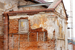 Old gungy wall with immured window Stock Photos