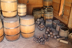 Old gunpowder barrels and cannonballs. In the armory stock photography