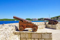 Old Guns, Korcula. Old guns on the walls of the old town, in Korcula, Dalmatia, Croatia Royalty Free Stock Photography