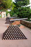 Old guns in Monaco-Ville. Old guns and gun's bullets in the Place du Palais square (palace square), Monaco-Ville, Monaco Royalty Free Stock Image