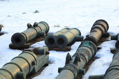 Old guns on snow royalty free stock image