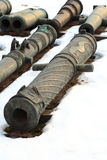 Old guns on snow closeup stock photo