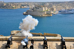 Old guns of Valletta, Malta. VALLETTA, MALTA - FEBRUARY 19: Midday start of saluting Lascaris Battery in Valletta city on February 19, 2014. Valletta is a Stock Photos