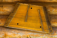 Old gusli hanging on the wall. Day Royalty Free Stock Images